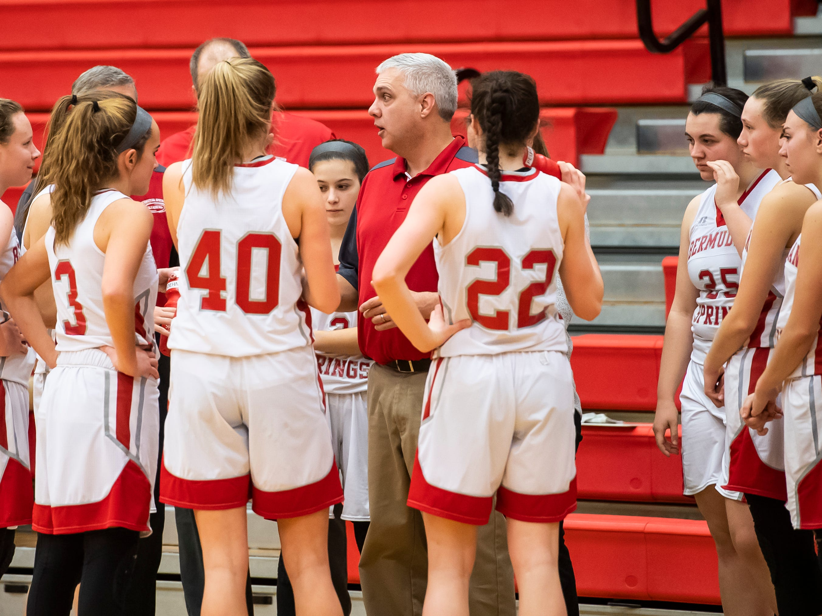 Bermudian Springs' head coach Todd Askins speaks with his players during a timeout against York Country Day School at Bermudian Springs High School on Monday, January 14, 2019. The Eagles won 59-20.