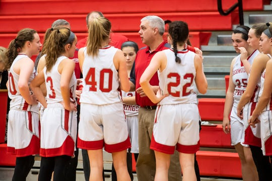 Bermudian Springs' head coach Todd Askins speaks with his players during a timeout against York Country Day School at Bermudian Springs High School on Monday, January 14, 2019. The Eagles, a team that starts three freshmen players, won 59-20.