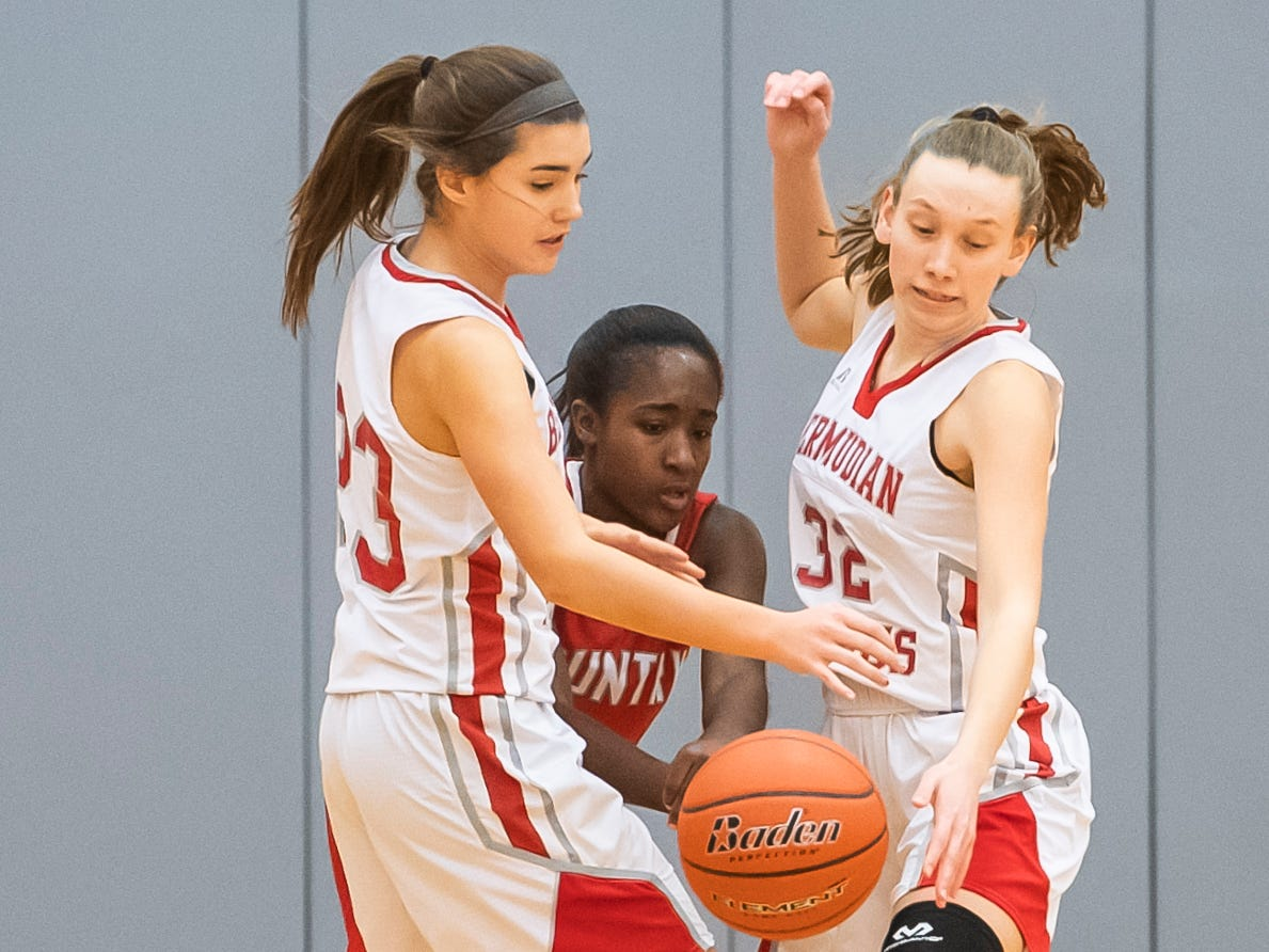 Bermudian Springs' Bailey Oehmig, left, and Arden Bealmear force the turnover on York Country Day School's  Cheyenne Thames at Bermudian Springs High School on Monday, January 14, 2019. The Eagles won 59-20.