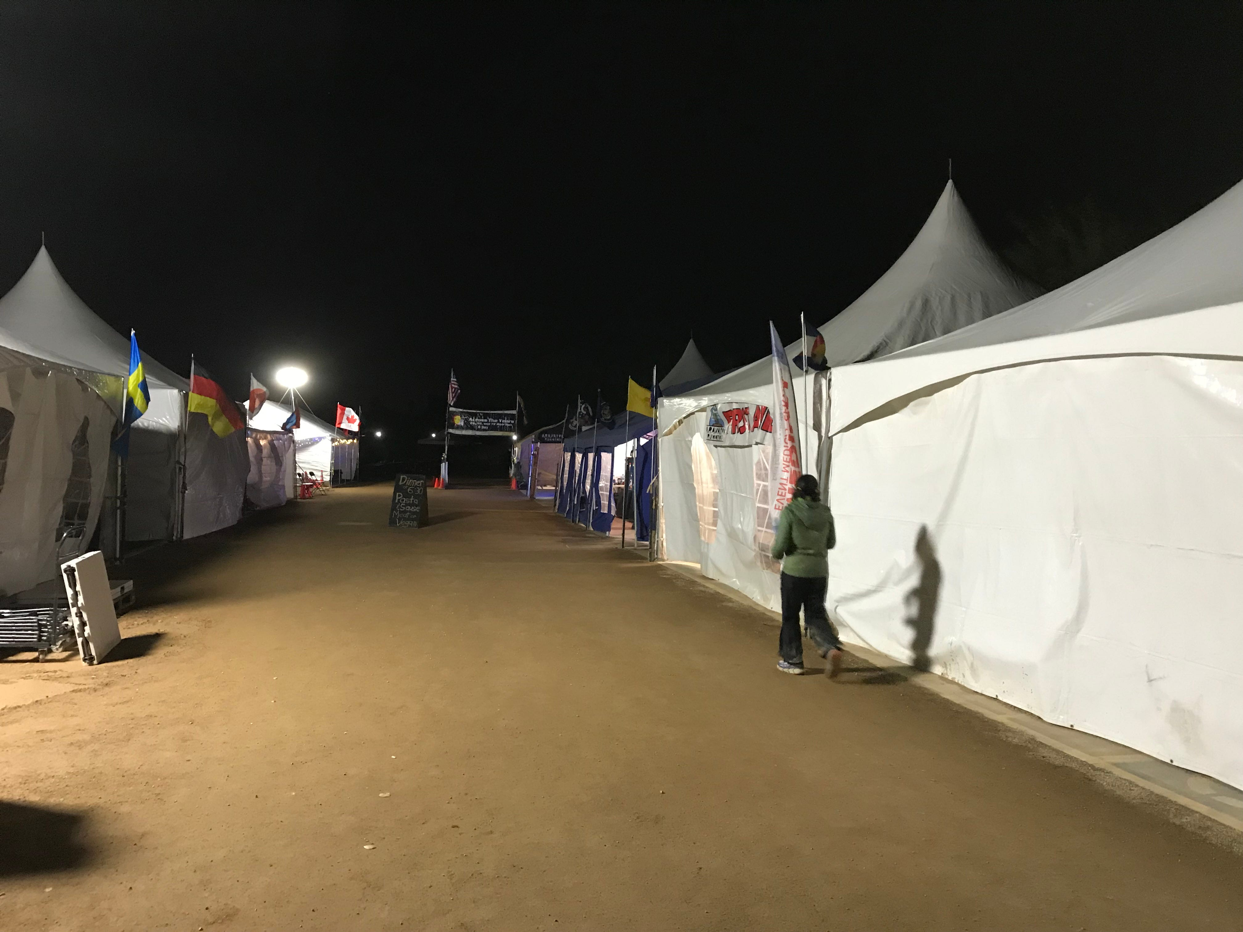Hours before sunrise, a solitary runner approaches the Across the Years start line at Camelback Ranch in Glendale. Entrants competed in one-, two-, three- and six-day ultramarathons.