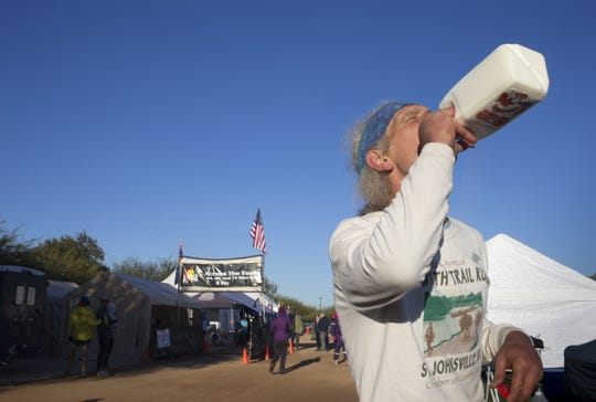 John Geesler gets a drink of milk, January 3, 2019, after finishing the Across the Years Race at Camelback Ranch, 10710 W Camelback Road, Glendale. Geesler finished the six-day race with 395 laps/414 miles, placing him fifth.