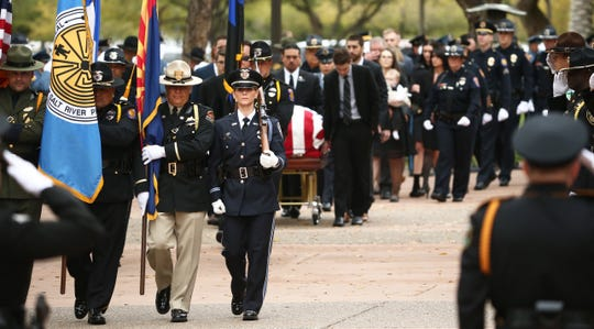 The flag-draped coffin carrying the body of Salt River tribal Officer Clayton Townsend arrives for his public funeral service on Jan. 15, 2019, at Christ's Church of the Valley in Peoria. Townsend was fatally struck while conducting a routine traffic stop on Loop 101 near McDowell Road east of Scottsdale.