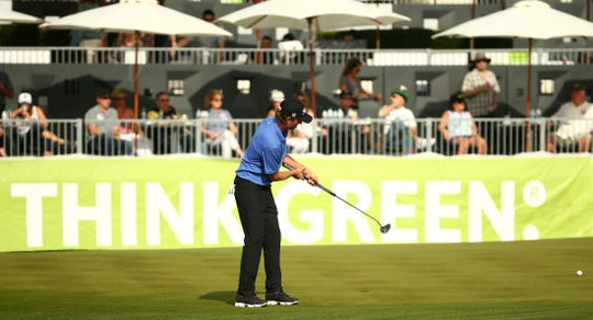 Webb Simpson putts onto the 17th green at TPC Scottsdale at the Waste Management Phoenix Open.