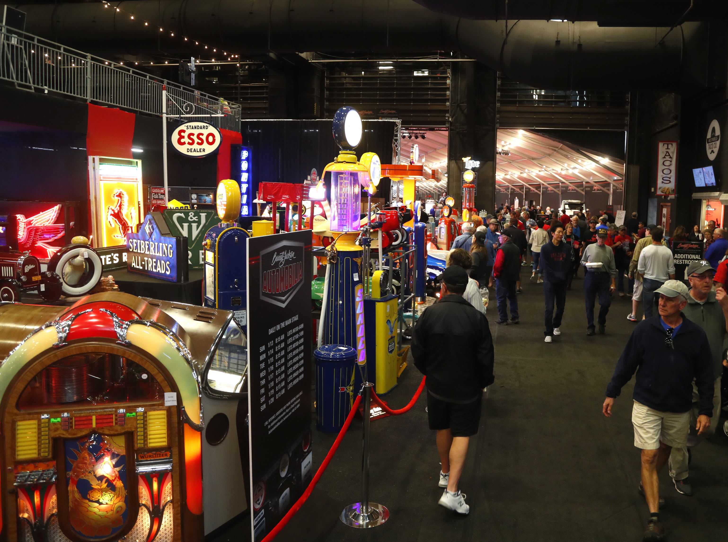 Car memorabilia lines the way to the cars at the Barrett-Jackson Car Auction in WestWorld in Scottsdale on Jan. 14, 2019.