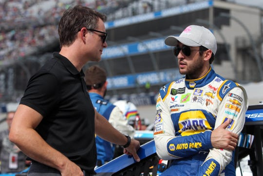 Oct 7, 2018: NASCAR Cup Series driver Chase Elliott (right) talks with former driver Jeff Gordon (left) prior to the Gander Outdoors 400 at Dover International Speedway.