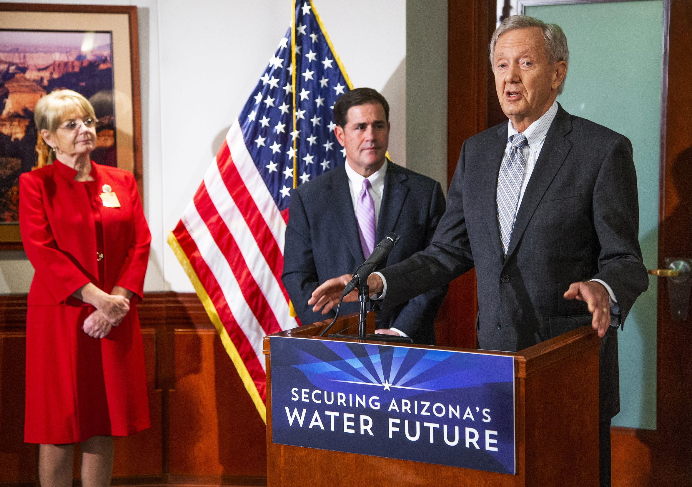 Former Arizona Gov. Bruce Babbitt (right) speaks at a press conference at the Arizona Capitol with government leaders to discuss water use, Jan. 15, 2019. Senate President Karen Fann (far left) and Gov. Doug Ducey also attended.