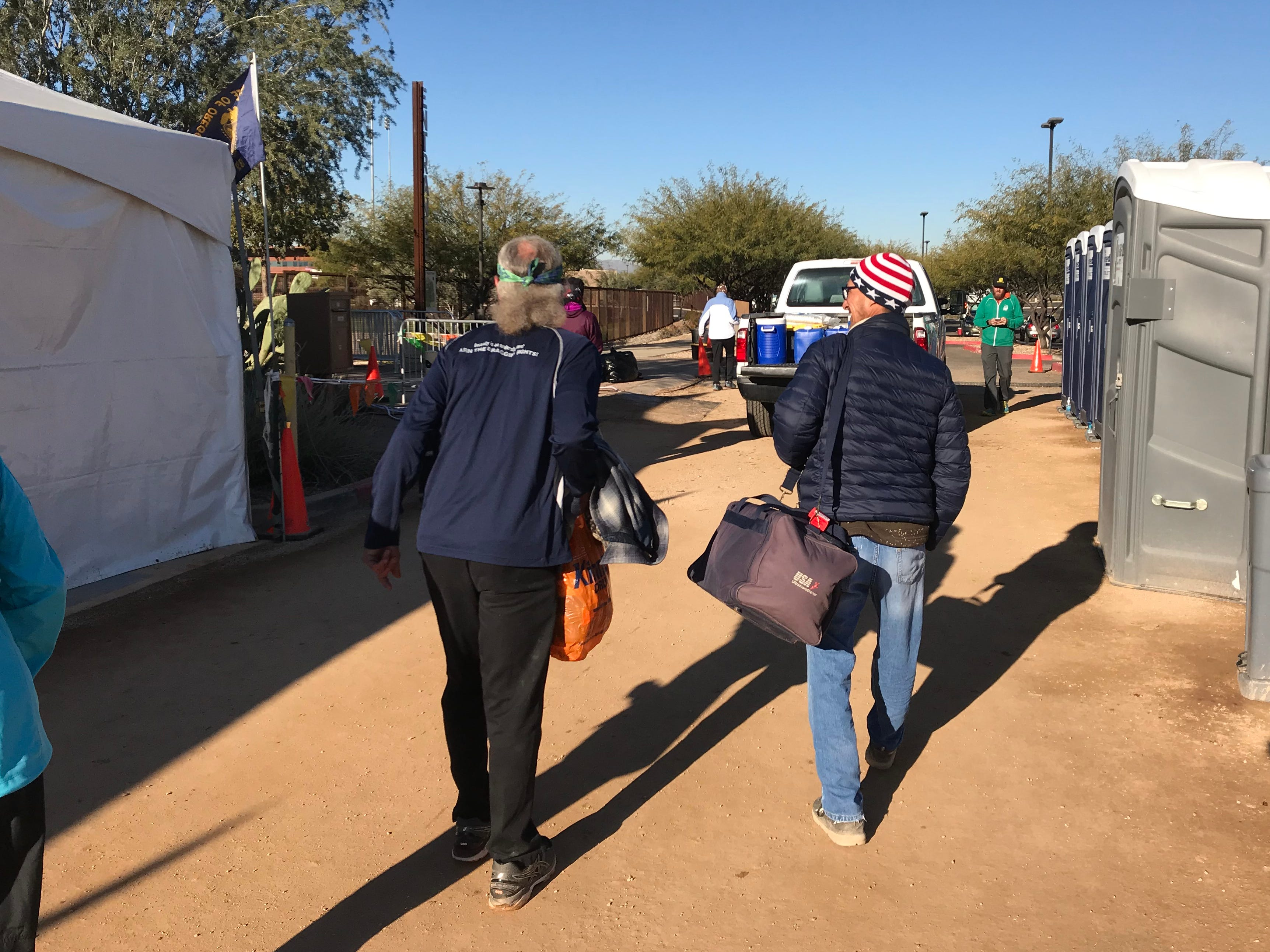 After running for six days on less than two hours of sleep during the Across the Years Race at Camelback Ranch in Glendale, John Geesler (left) leaves to catch an early flight.