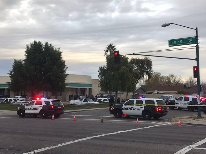 Traffic on 48th Street north of Baseline Road in Tempe was closed to traffic on Jan. 15, 2019, while police investigated a shooting involving an officer.