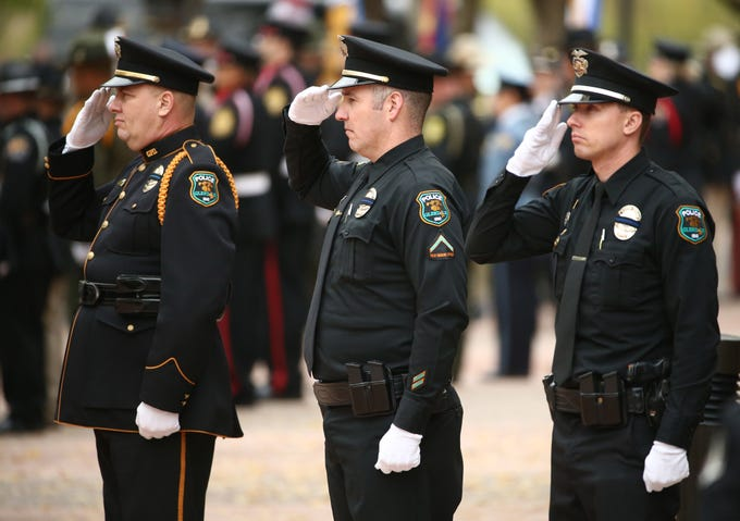 Glendale Police salute as the flag-draped coffin carrying the body of Salt River tribal Officer Clayton Townsend arrives for his public funeral service on Jan. 15, 2019, at Christ's Church of the Valley in Peoria. Townsend was fatally struck while conducting a routine traffic stop on Loop 101 near McDowell Road east of Scottsdale.