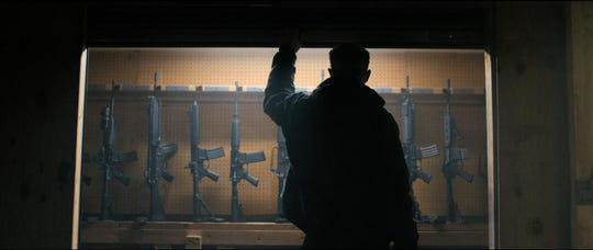 """When a militia discovers a missing AR-15 from its storage containers, ex-cop Gannon (James Badge Dale) interrogates his fellow militia members in """"The Standoff at Sparrow Creek."""""""