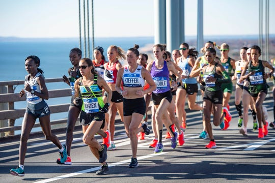 Allie Kieffer runs with the lead pack over the Verrazzano-Narrows Bridge at the 2018 New York City Marathon, where she finished seventh. Kieffer, who ran at ASU in 2009-10, will be in the Humana Rock 'n' Roll half marathon on Sunday.