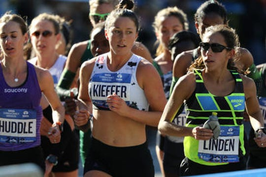 Allie Kieffer, center, runs between Molly Huddle and Desiree Linden at the 2018 New York City Marathon. Kieffer was seventh, one place behind fellow former Arizona State runner Linden.