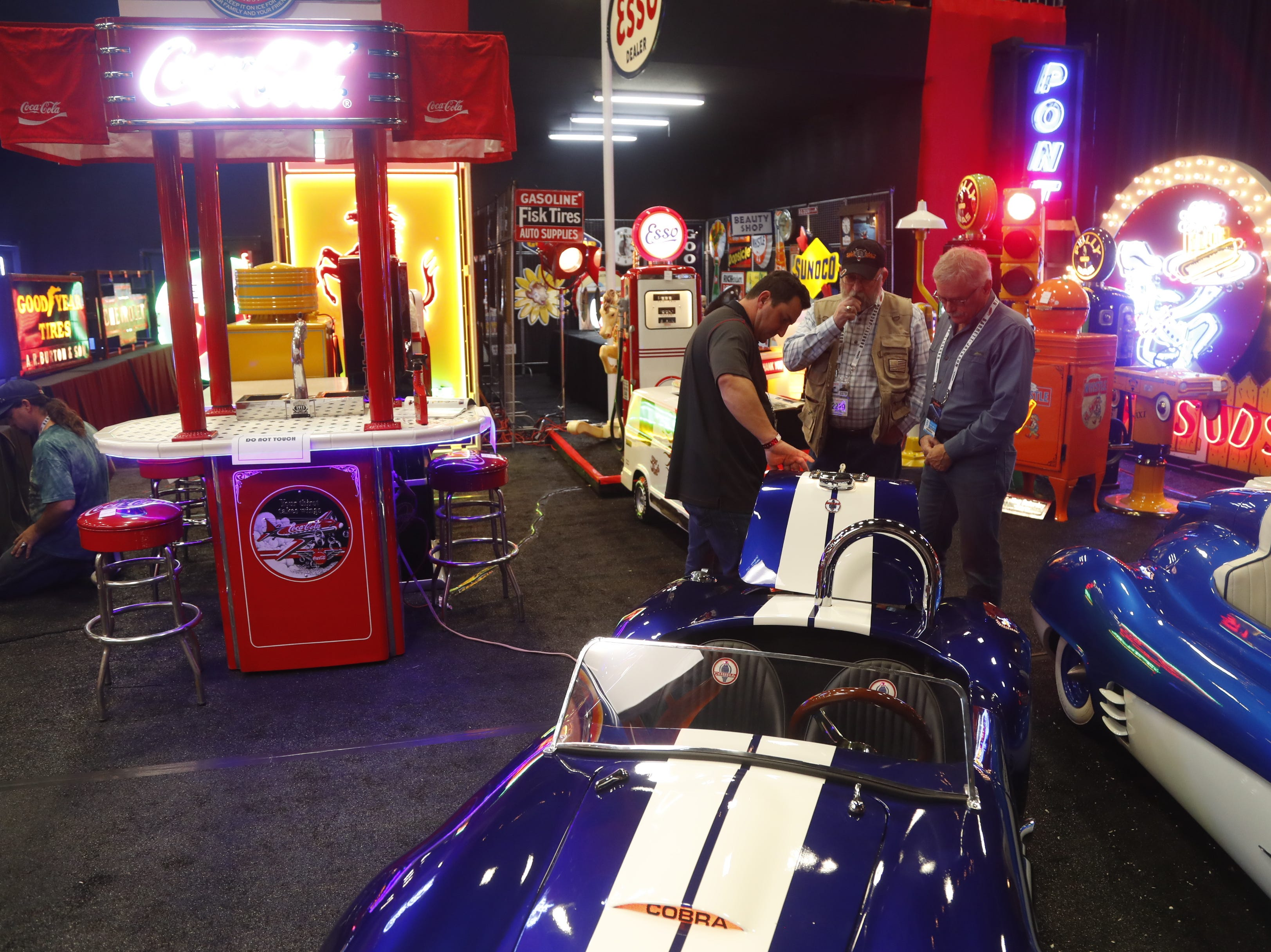 People look over the car memorabilia for auction and sale at the Barrett-Jackson Car Auction in WestWorld in Scottsdale on Jan. 14, 2019.