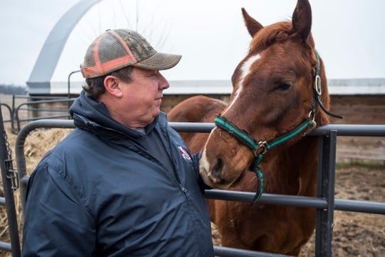 Michael Pratt pets Charlie, a 4-year-old horse on his Allenton farm Tuesday, Jan. 15, 2019.