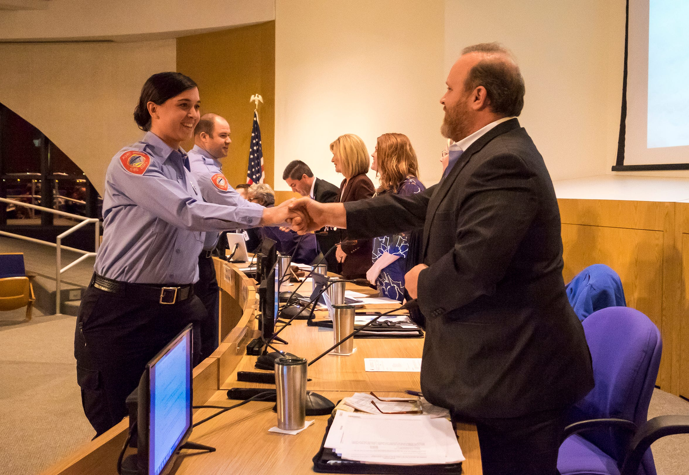 Port Huron Firefighter Jacqueline Martin, left, shakes hands with City Councilman Scott Worden after being introduced at a council meeting Monday, Jan. 14, 2019. She was one of several new fire department hires and is the second current female firefighter.