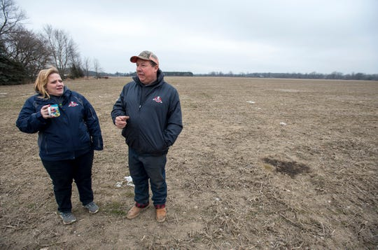 Michael and his wife Amy Pratt stand in one of their winter wheat fields Tuesday, Jan. 15, 2019 on their farm in Allenton.