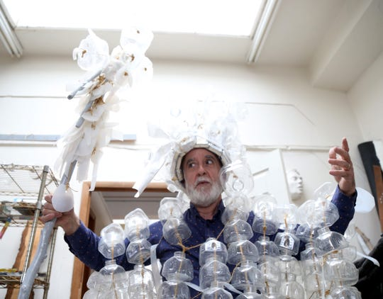 Andres San Millan wears a costume he created while in his studio inside the Cunneen Hackett Arts Center in the City of Poughkeepsie on January 8, 2019.