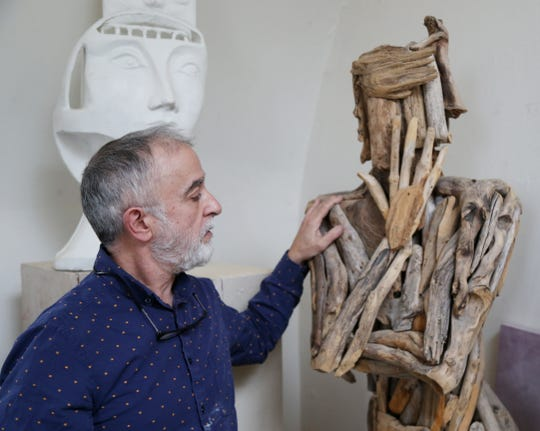 Andres San Millan with a figure he made with driftwood from the Hudson River at his studio in the City of Poughkeepsie on January 8, 2019.