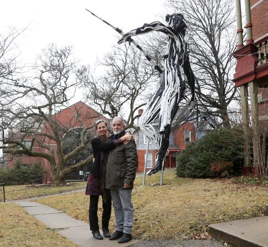 Andres and Marguerite San Millan below one of their sculptures outside the Cunneen Hackett Arts Center in the City of Poughkeepsie on January 8, 2019. The pair founded Cocoon Theatre in 1987 and have long running careers in fine & performing arts.