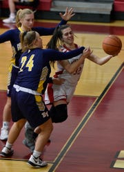 Kelsey Gemmill of Susquehannock makes a pass before going out to bounds while being covered by Cass Arnold, left, and Morgan Winter of Eastern York, Monday, January 14, 2019.John A. Pavoncello photo