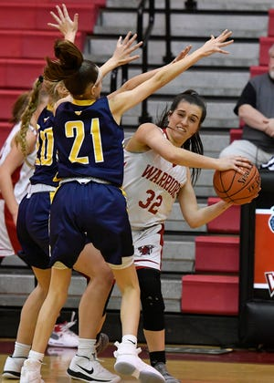 Susquehannock's Kelsey Gemmill, seen here at right in a file photo, had 17 points on Monday night in a 55-52 overtime victory over Northeastern. Gemmill had five 3-pointers.