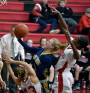 Eastern York's Cass Arnold earns a charging foul after running into Maddie Geiple of Susquehannock on her way to the basket, Monday, January 14, 2019.
