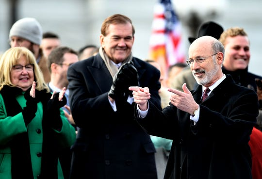 Pennsylvania Gov. Tom Wolf gestures while former governor Tom Ridge and his wife Michele applaud during Wolf's second inauguration ceremony outside the state capitol Tuesday, Jan. 15, 2019. Wolf beat fellow York Countian Scott Wagner in the November midterm election. Bill Kalina photo