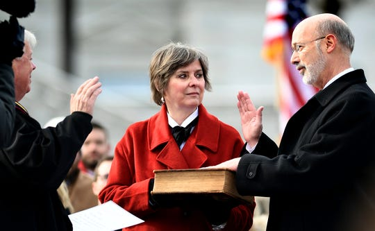 Pennsylvania Supreme Court Chief Justice Thomas Saylor swears-in Gov. Tom Wolf with Wolf's wife Frances during Wolf's second inauguration ceremony outside the state capitol Tuesday, Jan. 15, 2019. Bill Kalina photo