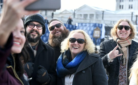 Sully Pinos, left, photographs herself and other members of the York County Economic Alliance during Pennsylvania Gov. Tom Wolf's second inauguration ceremony outside the state capitol Tuesday, Jan. 15, 2019. Bill Kalina photo
