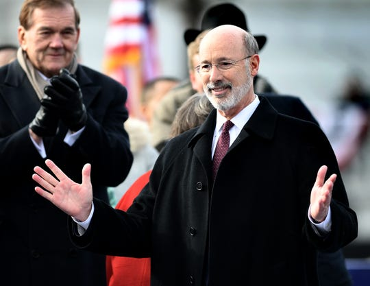 Pennsylvania Gov. Tom Wolf gestures while former governor Tom Ridge applauds during Wolf's second inauguration ceremony outside the state capitol Tuesday, Jan. 15, 2019. Wolf beat fellow York Countian Scott Wagner in the November midterm election. Bill Kalina photo