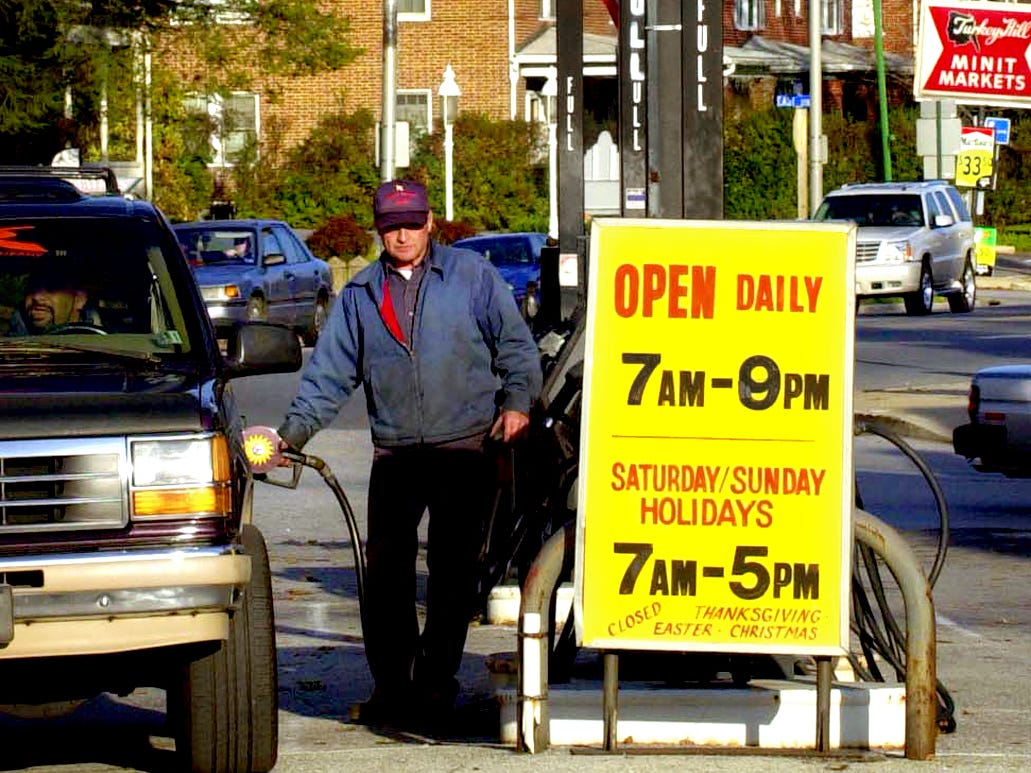 Lynn Haines fills gas tank at his Lincoln Highway Garage on East Market Street in November 2003.