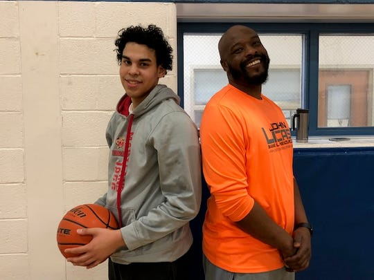 Former York High star Sam Sutton poses with his brother, Elijah, last season after a practice. Sam Sutton is the father of York Suburban freshman Savon Sutton.
