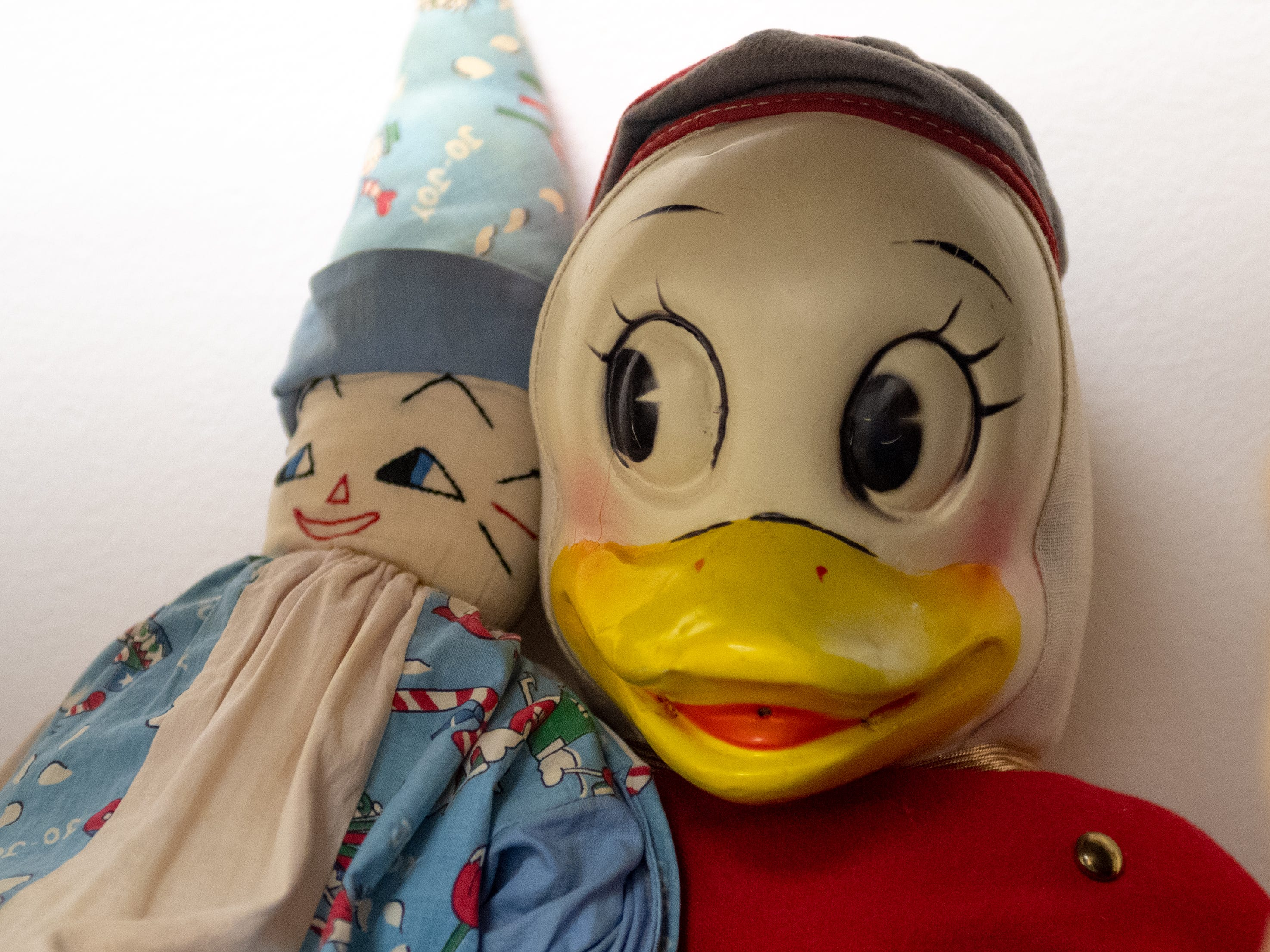 This clown and duck were two of John Judge's favorite things. They sit on the bookcase in Marilyn Tenenoff's office along with boxes full of his personal library, January 12, 2019.
