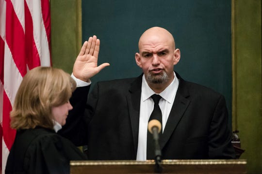 John Fetterman is sworn in as Pennsylvania's lieutenant governor by Superior Court Judge Judge Deborah Kunselman on Tuesday, Jan. 15, 2019, at the state Capitol in Harrisburg, Pa. (AP Photo/Matt Rourke)