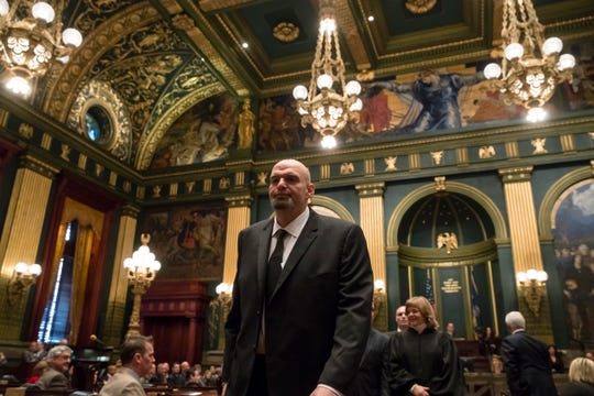 Pennsylvania Lieutenant Governor John Fetterman walks from the Senate chamber after he was sworn into office on Tuesday, Jan. 15, 2019, at the state Capitol in Harrisburg, Pa. (AP Photo/Matt Rourke)