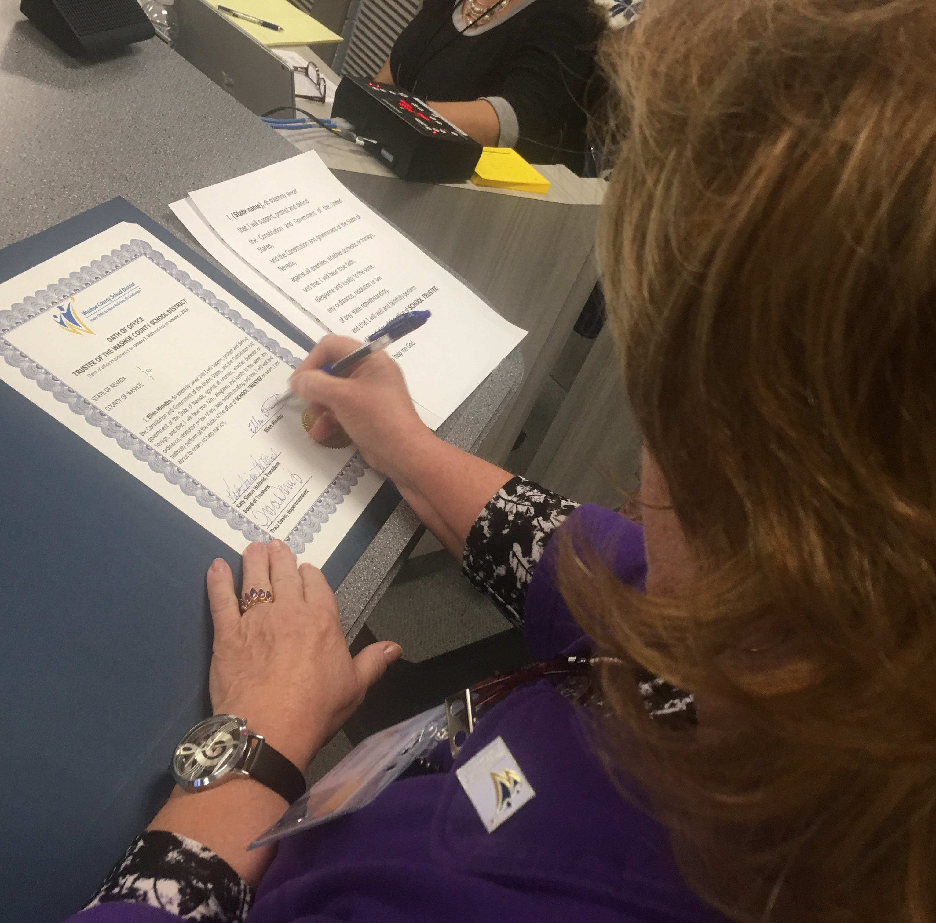 Ellen Minetto signs an Oath of Office at after being sworn in as a Washoe County School District Board.