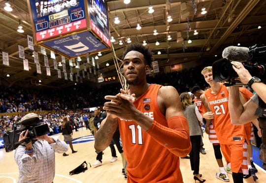 DURHAM, NORTH CAROLINA - JANUARY 14:  Oshae Brissett #11 of the Syracuse Orange celebrates as he leaves the floor after a win against the Duke Blue Devils at Cameron Indoor Stadium on January 14, 2019 in Durham, North Carolina. Syracuse won 95-91 in overtime. (Photo by Grant Halverson/Getty Images)