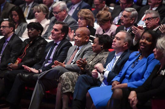Legislators listen as New York Gov. Andrew Cuomo deliver his State of the State address and executive budget proposal at the Hart Theatre, Tuesday, Jan. 15, 2019, in Albany, N.Y.