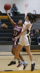 Edison's Dyaisha Fair, left, drives hard to the basket past HF-L's Ali McLean, right.