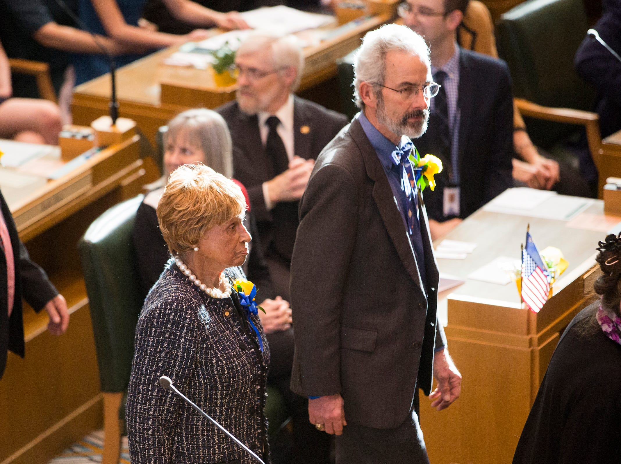 Sen. Jackie Winters, R-Salem, and Sen. Floyd Prozanski, D-Eugene, walk in before Governor Kate Brown addresses the state legislature at her inauguration at the Oregon State Capitol on Jan. 14, 2019.