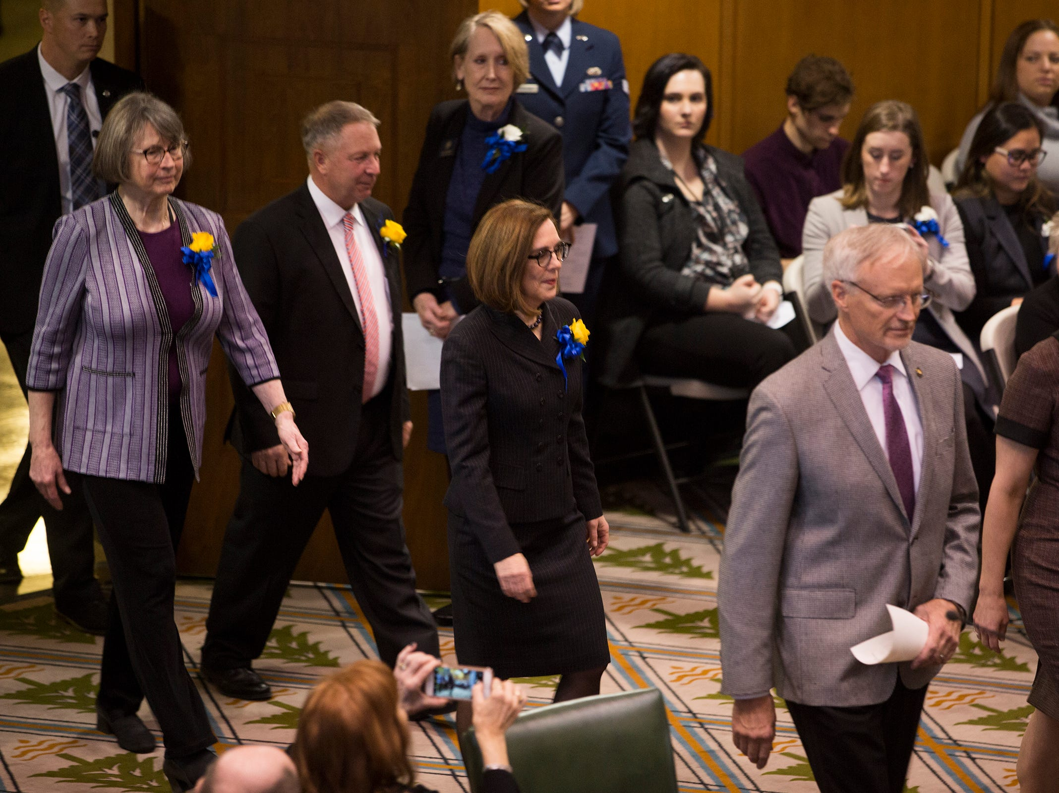 Governor Kate Brown walks in before she addresses the state legislature at her inauguration at the Oregon State Capitol on Jan. 14, 2019.