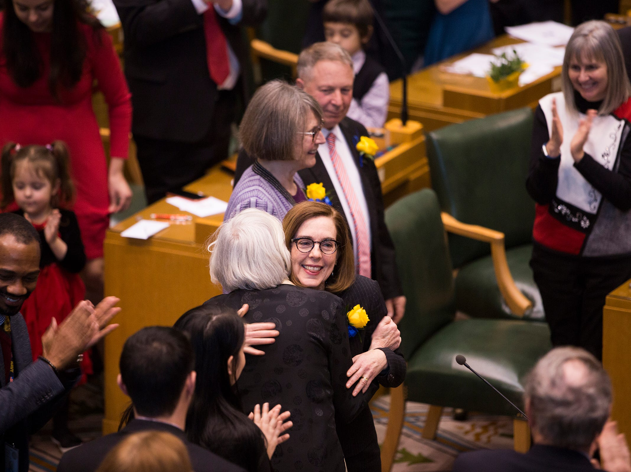 Governor Kate Brown greets people as she walks in before she addresses the state legislature at her inauguration at the Oregon State Capitol on Jan. 14, 2019.