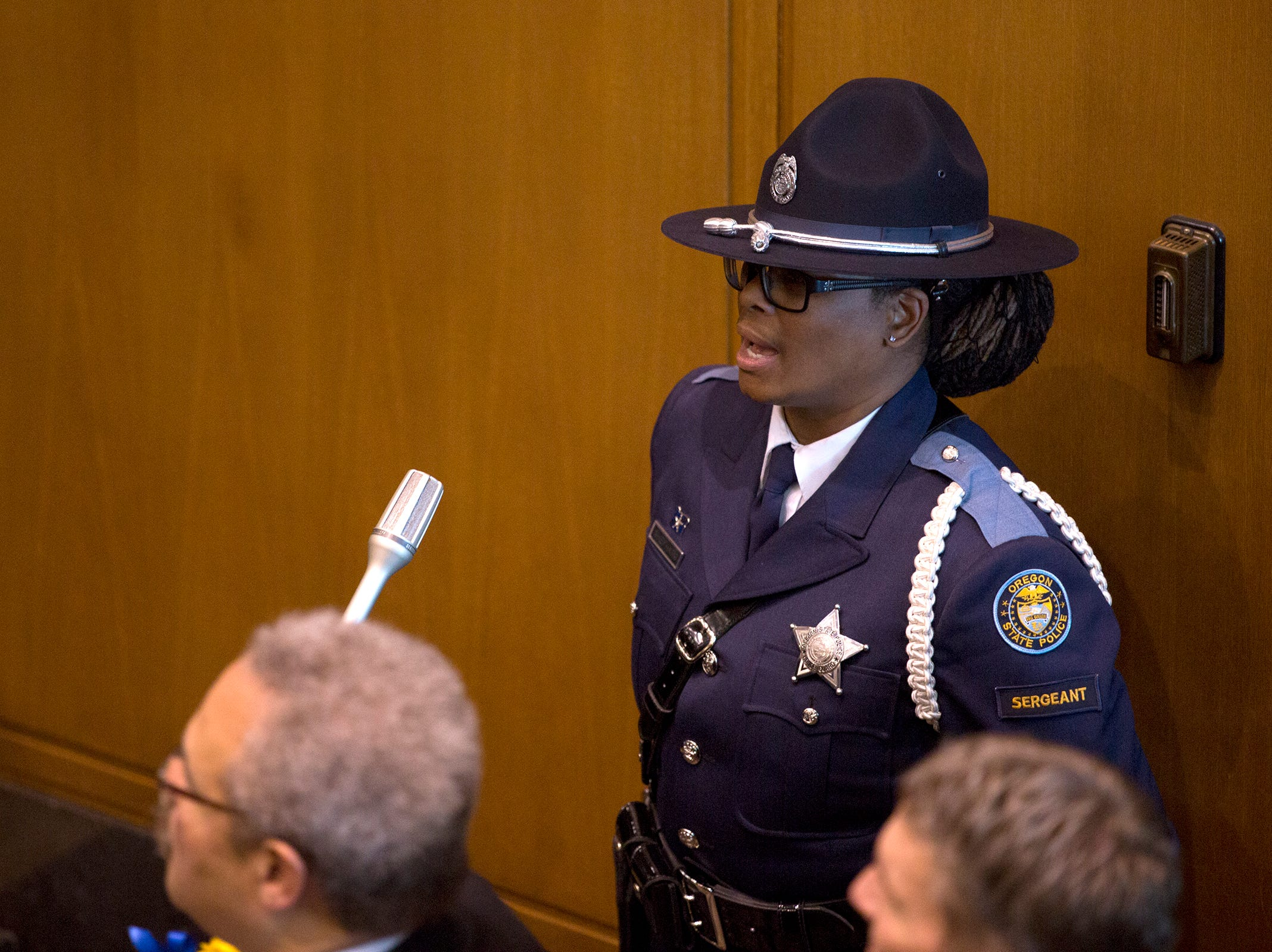 Patrol Sergeant Yvette Shephard sings The Star Spangled Banner before Governor Kate Brown addresses the state legislature at her inauguration at the Oregon State Capitol on Jan. 14, 2019.