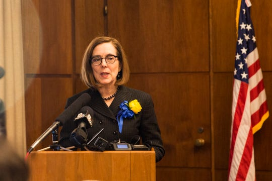 Governor Kate Brown addresses the media following her inauguration at the Oregon State Capitol on Jan. 14, 2019.
