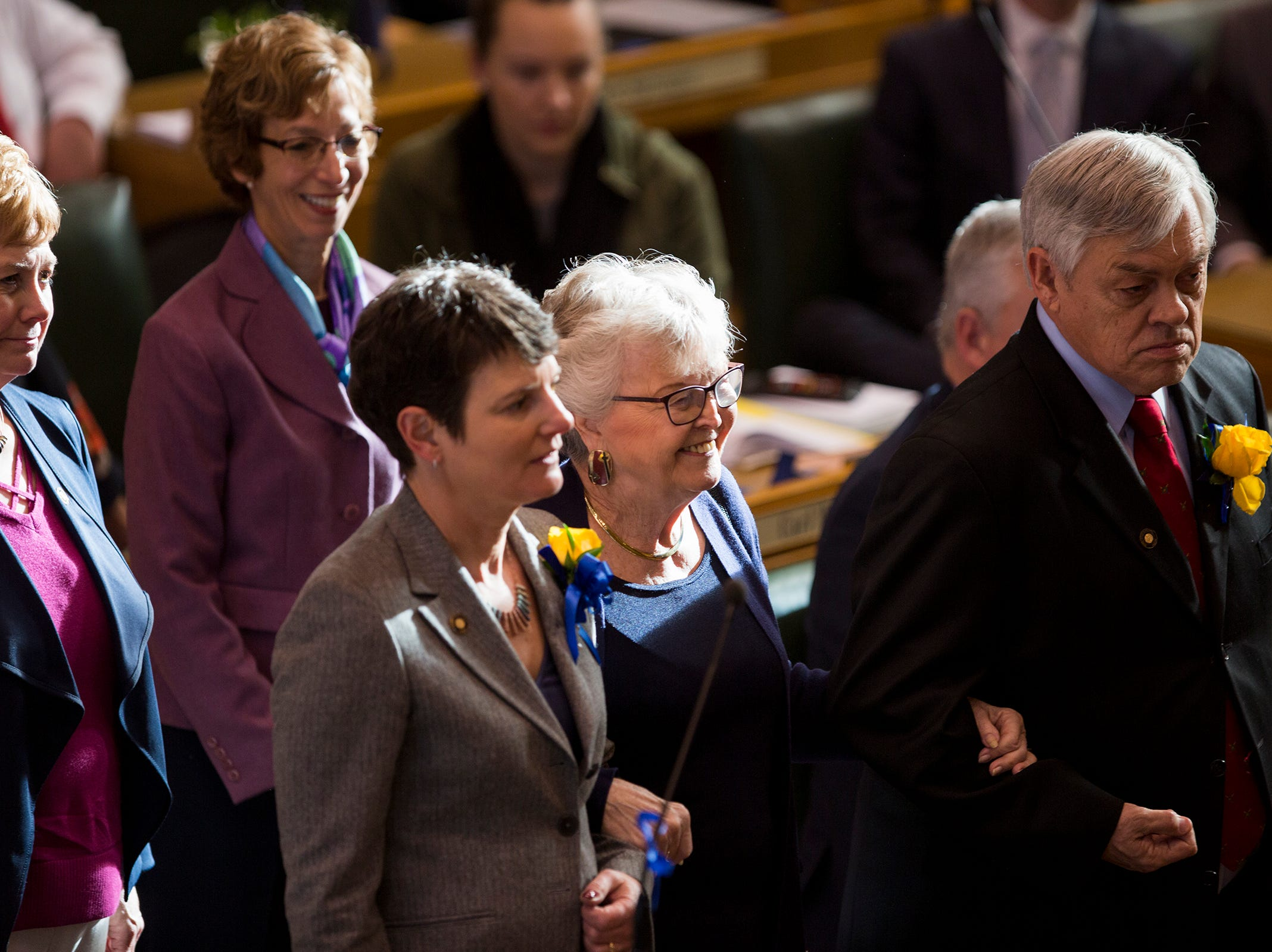 Former Governor Barbara Roberts is escorted into the House chamber before Kate Brown's inauguration at the Oregon State Capitol on Jan. 14, 2019.