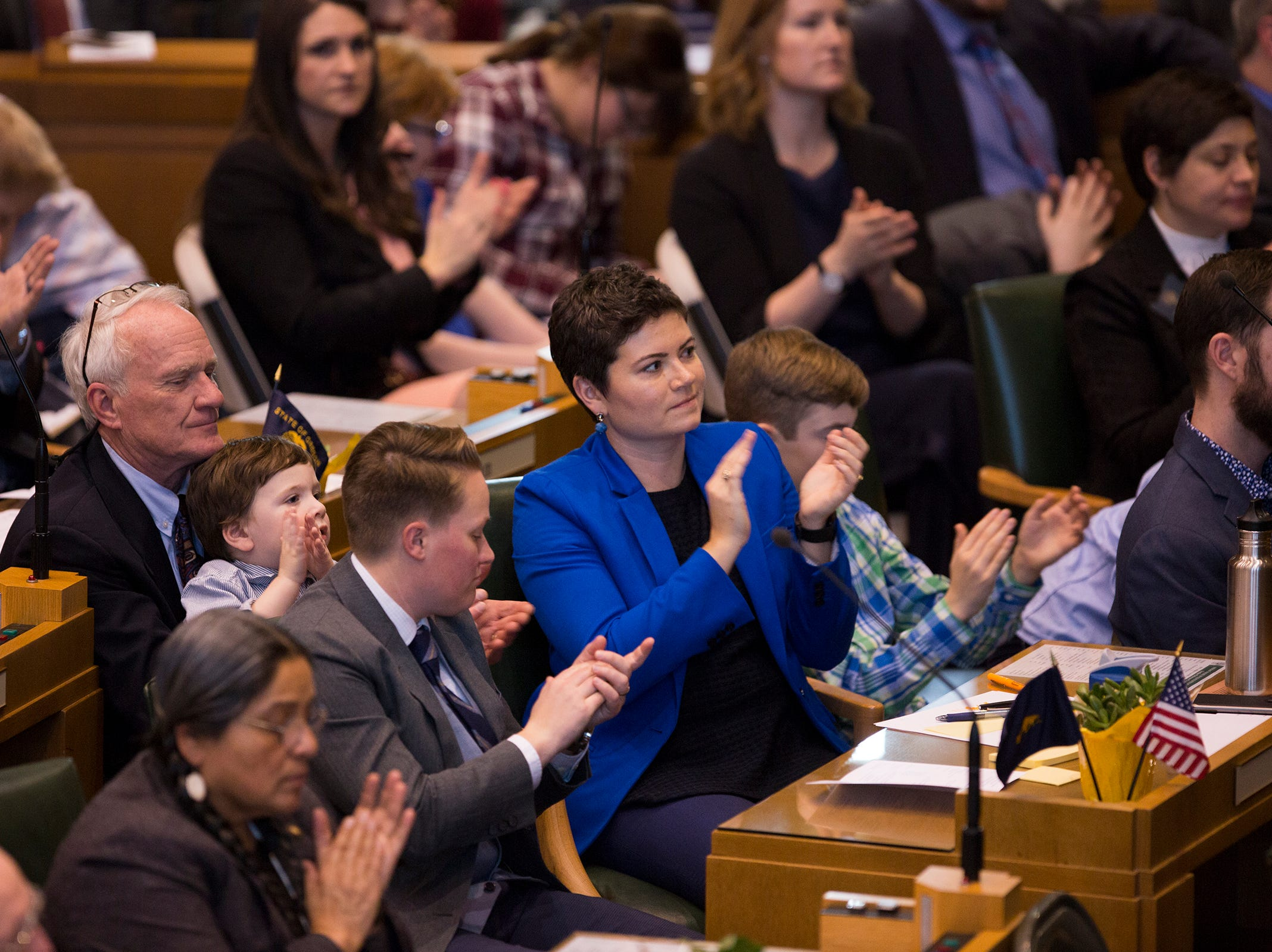 Oregon state officials listen to Governor Kate Brown address the state legislature at her inauguration at the Oregon State Capitol on Jan. 14, 2019.