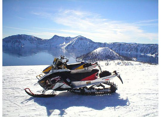 Amid the government shutdown limiting access to Crater Lake National Park, snowmobiles offer the easiest access.