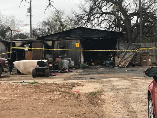 A garage with a living space sits damaged at 1315 S. Bryan Street Monday, Jan. 14, 2019.