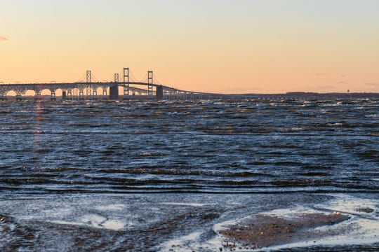 The sun sets over the Chesapeake Bay Bridge in Terrapin Nature Park on Thursday, Jan 10, 2019.