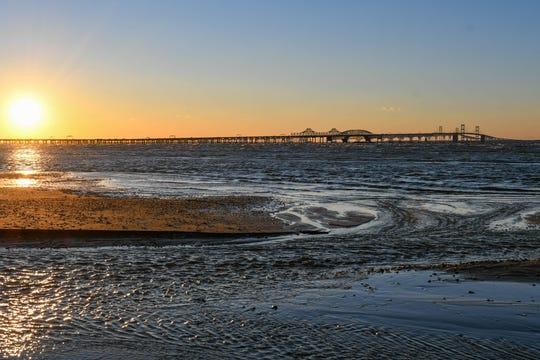 The sun sets over the Chesapeake Bay Bridge in Terrapin Nature Park on Thursday, Jan 10, 2019.